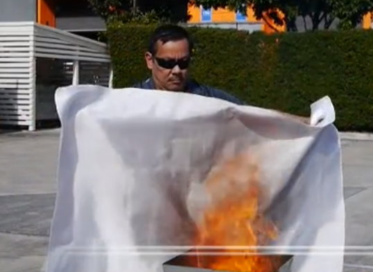 man using fire blanket