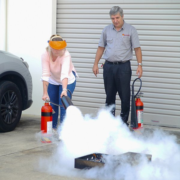 teaching people to use a fire extinguisher